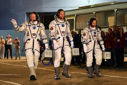 US astronaut Barry Wilmore (R), Russia's cosmonauts Alexander Samokutyayev (C) and Yelena Serova (L) Alexander Samokutyayev (C) before the launch of the the Soyuz TMA-14M spacecraft at the Russian-leased Baikonur cosmodrome on September 25, 2014. The launch of the Soyuz TMA-14M with the international crew aboard is scheduled early on September 26 local time.  AFP PHOTO / VASILY MAXIMOV        (Photo credit should read VASILY MAXIMOV/AFP/Getty Images)