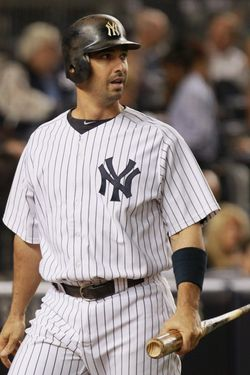 NEW YORK, NY - OCTOBER 06:  Jorge Posada #20 of the New York Yankees reacts after Posada struck out looking to end the bottom of the second inning against the Detroit Tigers during Game Five of the American League Championship Series at Yankee Stadium on October 6, 2011 in the Bronx borough of New York City.  (Photo by Nick Laham/Getty Images)