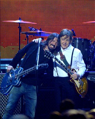 Musicians Dave Grohl (L) and Sir Paul McCartney perform onstage at the 2012 MusiCares Person of the Year Tribute to Paul McCartney held at the Los Angeles Convention Center on February 10, 2012 in Los Angeles, California.