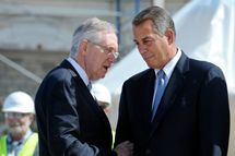 Senate Majority Leader Harry Reid, D-Nev., left, holds Speaker of the House John Boehner, R-Oh., arm as they talk during the First Nail Ceremony for the official launch of construction of the Inaugural platform where the President of the United States will take the oath of office on the West Front of the U.S. Capitol in Washington, Thursday, Sept. 20, 2012. (AP Photo/Cliff Owen)