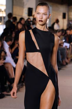 Model Karlie Kloss presents a creation by Italian fashion designer Anthony Vaccarello during the Spring/Summer 2012 ready-to-wear collection show, on September 27, 2011 in Paris. AFP PHOTO/FRANCOIS GUILLOT (Photo credit should read FRANCOIS GUILLOT/AFP/Getty Images)
