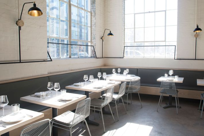 The restaurant occupies a former auto-body shop. Casement windows let in tons of light.