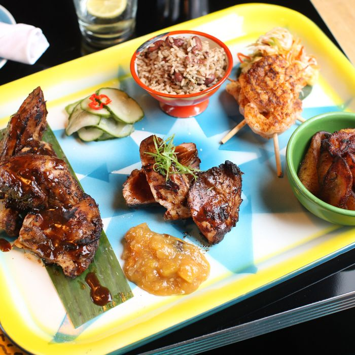 Jerk chicken, pork, and shrimp with rice and peas, charred pineapple slaw, sweet plantains, and mango chutney.