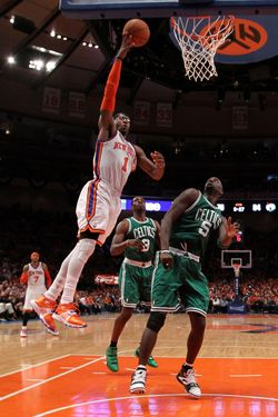 NEW YORK, NY - APRIL 24:  Amar'e Stoudemire #1 of the New York Knicks attempts a shot against Kevin Garnett #5 of the Boston Celtics in Game Four of the Eastern Conference Quarterfinals during the 2011 NBA Playoffs on April 24, 2011 at Madison Square Garden in New York City. NOTE TO USER: User expressly acknowledges and agrees that, by downloading and or using this photograph, User is consenting to the terms and conditions of the Getty Images License Agreement  (Photo by Nick Laham/Getty Images)
