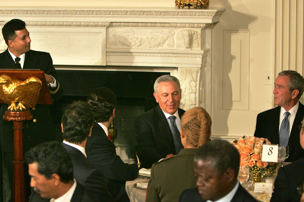 Navy Imam Chaplain Lt. Cmdr. Abuhena M. Saifulislam (L) gives the prayer at the Iftaar Dinner as President George W. Bush (R) and His Excellency Aziz Mekouar (C), Moroccan ambassador to the U.S., look on in the State Dining Room of the White House October 4, 2007 in Washington, DC. During the traditional meal that breaks the daily fast during Ramadan, President Bush said that the U.S. has a proud history of standing with Muslims.
