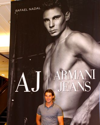 There has to be something awkward about standing in front of a giant shirtless picture of yourself, right?