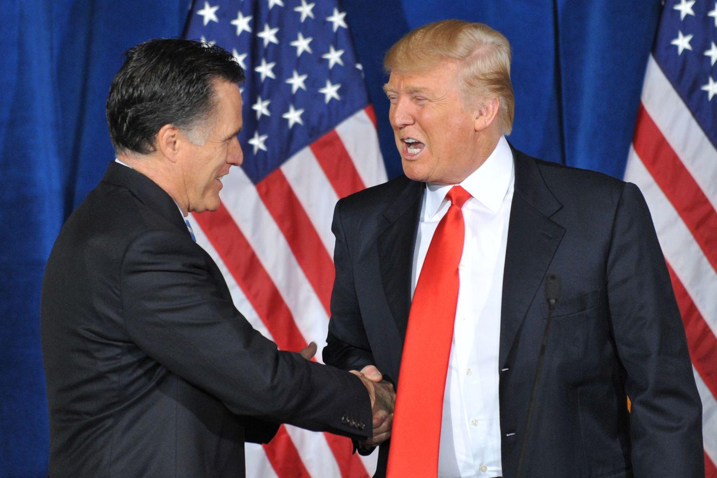 Businessman Donald Trump (R) shakes hands with Republican presidential hopeful Mitt Romney