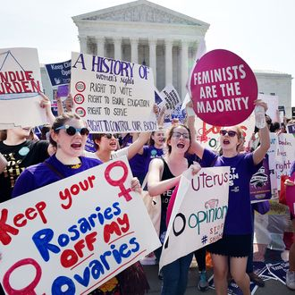 Abortion rights activists cheer after the US Supreme Court struck down a Texas law placing restrictions on abortion clinics, outside of the Supreme Court on June 27, 2016 in Washington, DC.