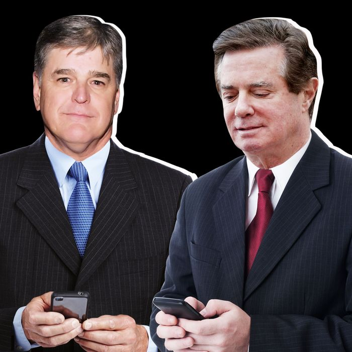 Sean Hannity and Paul Manafort, each holding cell phones.
