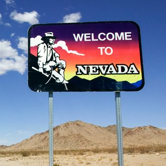 Desert Highway in Nevada with Welcome Sign