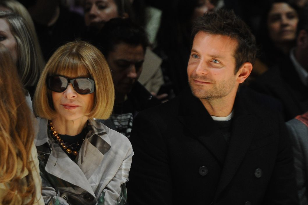 Anna Wintour (L) and Bradley Cooper attend the front row at Burberry Womenswear Autumn/Winter 2014 at Kensington Gardens on February 17, 2014 in London, England.