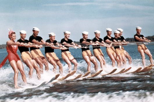 WINTERHAVEN, FL - 1953:  A group of acrobatic water skiers including aquatic film star Esther Williams (far left) perform during the filming of 'Easy To Love' at Cypress Gardens theme park in 1953 near Winterhaven, Florida. (Photo by Michael Ochs Archives/Getty Images)