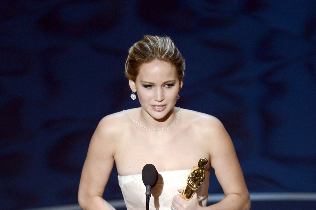 "HOLLYWOOD, CA - FEBRUARY 24:  Actress Jennifer Lawrence accepts the Best Actress award for ""Silver Linings Playbook"" during the Oscars held at the Dolby Theatre on February 24, 2013 in Hollywood, California.  (Photo by Kevin Winter/Getty Images)"