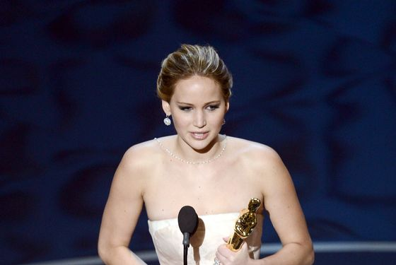 "HOLLYWOOD, CA - FEBRUARY 24:  Actress Jennifer Lawrence accepts the Best Actress award for ""Silver Linings Playbook"" during th"