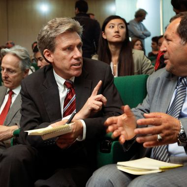 FILE - In this Monday, April 11, 2011 file photo, U.S. envoy Chris Stevens, center, accompanied by British envoy Christopher Prentice, left, speaks to Council member for Misrata Dr. Suleiman Fortia, right, at the Tibesty Hotel where an African Union delegation was meeting with opposition leaders in Benghazi, Libya. Libyan officials say the U.S. ambassador and three other Americans have been killed in an attack on the U.S. consulate in the eastern city of Benghazi by protesters angry over a film that ridiculed Islam's Prophet Muhammad. The officials say Ambassador Chris Stevens was killed Tuesday night when he and a group of embassy employees went to the consulate to try to evacuate staff. The protesters were firing gunshots and rocket propelled grenades. (AP Photo/Ben Curtis, File)