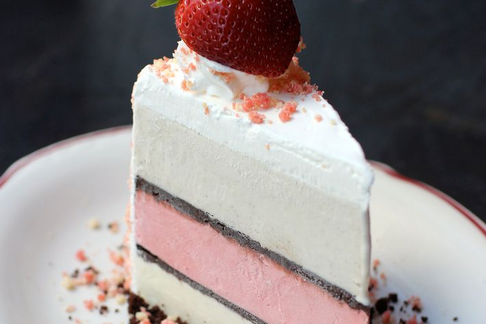 The layers within: strawberry, yellow cake, and vanilla bean.
