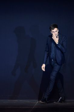 French-born Hedi Slimane  for Saint Laurent acknowledges the public during the Spring/Summer 2013 ready-to-wear collection show on October 1, 2012 in Paris. AFP PHOTO/MARTIN BUREAU        (Photo credit should read MARTIN BUREAU/AFP/GettyImages)