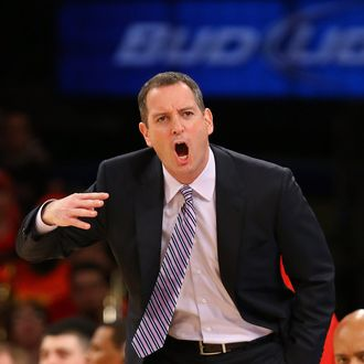Head coach Mike Rice of the Rutgers Scarlet Knights shouts instructions to his team against Notre Dame Fighting Irish during the second round of the Big East Tournament at Madison Square Garden on March 13, 2013 in New York City.