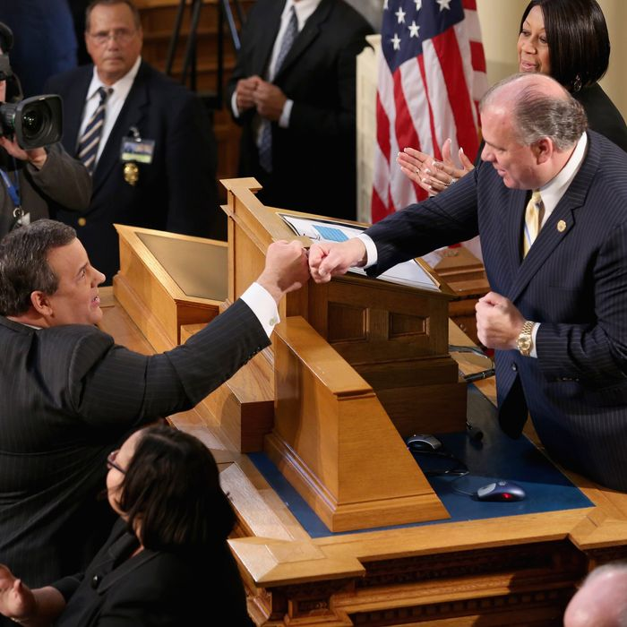 Republican New Jersey Governor Chris Christie (L), greets New Jersey Senate President Steve Sweeney, a Democrat, before Christie's State of the State Address in the Assembly Chamber at the Statehouse on January 8, 2013 in Trenton, New Jersey.