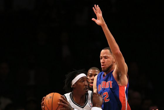 NEW YORK, NY - DECEMBER 14: Gerald Wallace #45 of the Brooklyn Nets tries to get around Tayshaun Prince #22 of the Detroit Pistons on December 14, 2012 at the Barclays Center in the Brooklyn borough of New York City. NOTE TO USER: User expressly acknowledges and agrees that, by downloading and/or using this photograph, user is consenting to the terms and conditions of the Getty Images License Agreement. (Photo by Elsa/Getty Images)