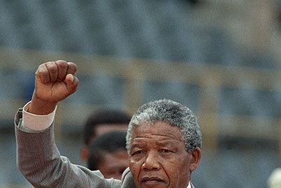 Anti-Apartheid leader and African National Congress (ANC) member Nelson Mandela raises clenched fist, arriving to address mass rally, a few days after his release from jail, February 25, 1990, in the conservative Afrikaaner town of Bloemfontein, where ANC was formed 75 years earlier.