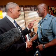 "FLORRISSANT, MO - AUGUST 20:  U.S. Attorney General Eric Holder (L) talks with Capt. Ron Johnson, right, of the Missouri State Highway Patrol at Drake's Place Restaurant,August 20, 2014 in Florrissant, Missouri. Holder is traveling to Ferguson, Mo., to oversea the federal government's investigation into the shooting of 18-year-old Michael Brown by a police officer on Aug. 9th. Holder promised a ""fair and thorough"" investigation into the fatal shooting of a young blackman, Michael Brown, who was unarmed when a white police officer shot him multiple times. (Photo by Pablo Martinez Monsivais-Pool/Getty Images)"