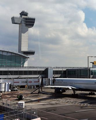 A plane waits at John F. Kennedy Airport on February 28, 2013 in New York City. Should the $85 billion in automatic federal budget cuts, known as the sequester, go into effect Friday as scheduled, airport control towers in a number of states could close, putting pilots and staff members at risk. In addition to the closed control towers, Transportation Security Administration (TSA) workers could be furloughed, leading to long waits and confusion at many airport security checkpoints.