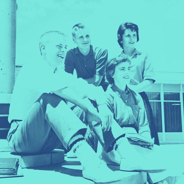 Two teenage boys and two teenage girls sitting together