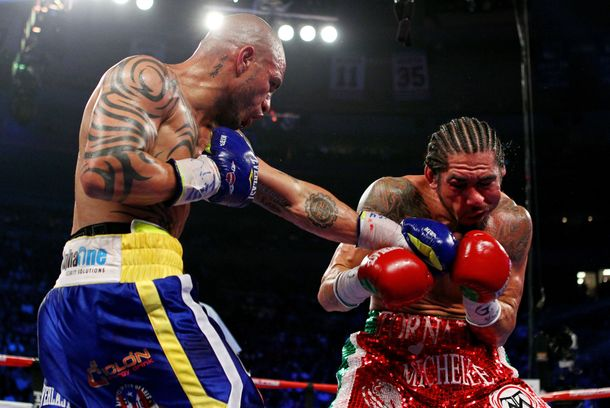 NEW YORK, NY - DECEMBER 03:  Miguel Cotto (L) of Puerto Rico connects with a left handed punch against Antonio Margarito of Mexico during the WBA World Junior Middleweight Title fight at Madison Square Garden on December 3, 2011 in New York City.  (Photo by Al Bello/Getty Images)