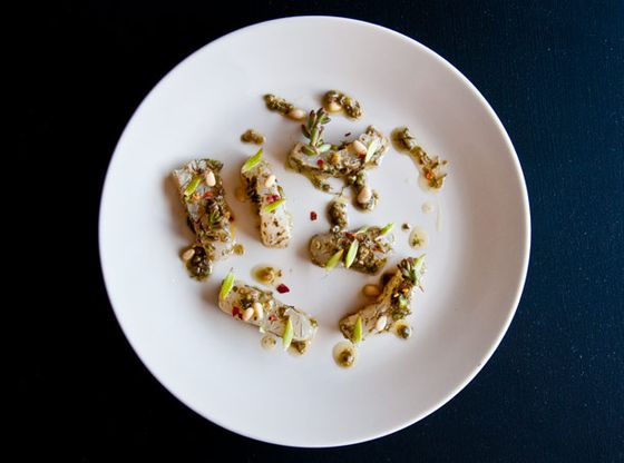 Marinated fluke with caper, bronze fennel, and pine nuts.
