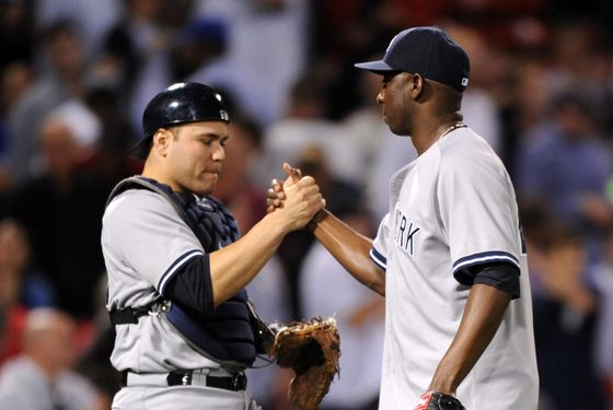 BOSTON, MA - SEPTEMBER  13:  Catcher Russell Martin #55 and pitcher Rafael Soriano #29 of the New York Yankees celebrate a 2-0 win over the Boston Red Sox on September 13, 2012 at Fenway Park in Boston, Massachusetts. (Photo by Michael Ivins/Boston Red Sox/Getty Images)