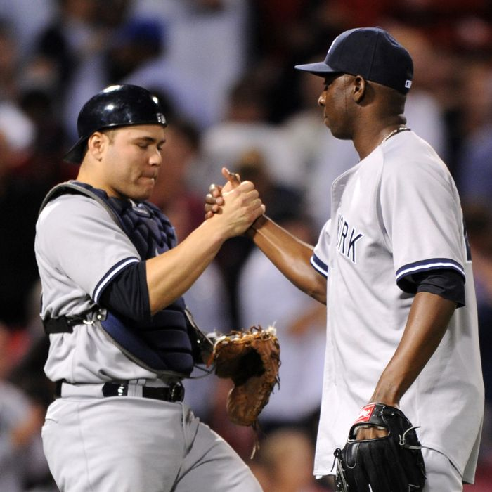 Catcher Russell Martin #55 and pitcher Rafael Soriano #29 of the New York Yankees celebrate a 2-0 win over the Boston Red Sox on September 13, 2012 at Fenway Park in Boston, Massachusetts.