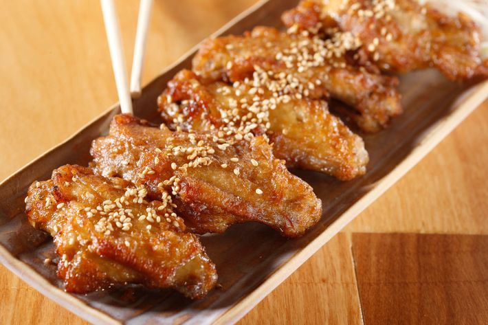 Tebasaki karage: Japanese fried chicken wings with sesame, soy sauce, and white pepper.
