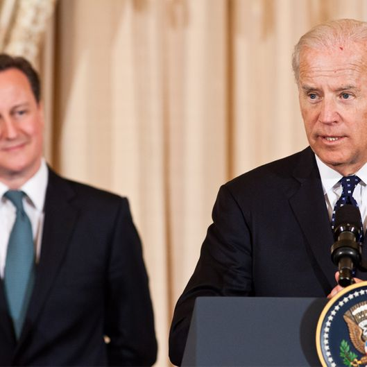British Prime Minister David Cameron (L) listens as U.S. Vice President Joe Biden makes a toast during a lunch hosted at the State Department on March 14, 2012 in Washington, DC.