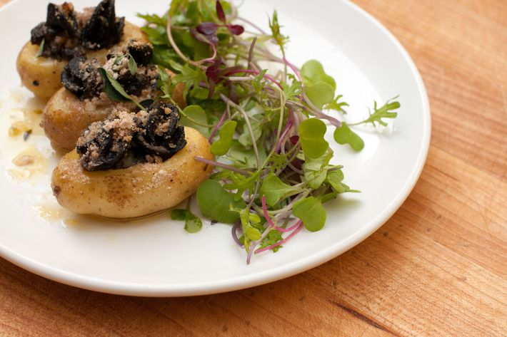 Confit Charlotte potatoes stuffed with snails.