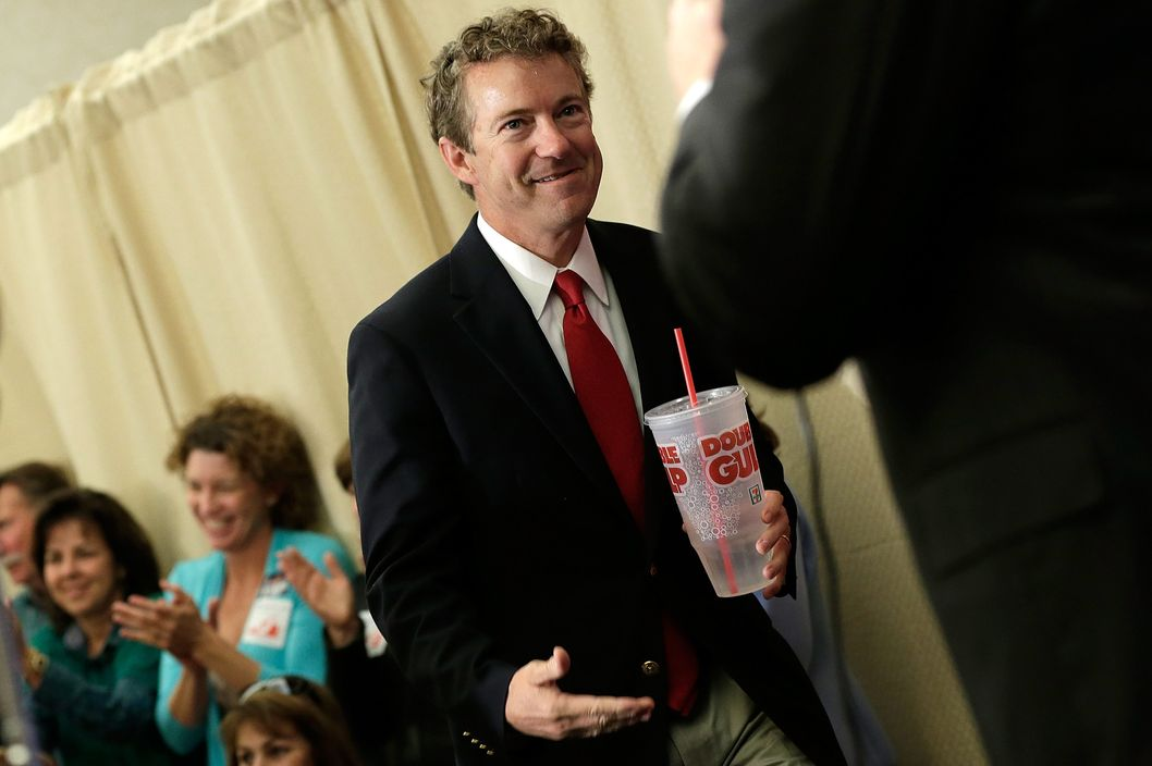 "FAIRFAX, VA - OCTOBER 28:  Holding a ""Big Gulp"" while referencing New York City Mayor Michael Bloomberg, U.S. Sen. Rand Paul (R-KY) arrives at a ""Get out the Vote"" rally for Virginia Attorney General Ken Cuccinelli, the Republican candidate for Governor of Virginia, October 28, 2013 in Fairfax, Virginia. Cuccinelli is running against Democratic candidate Terry McAullife in a very close race.  (Photo by Win McNamee/Getty Images)"