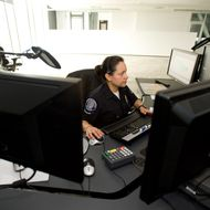 911 dispatcher Leticia Hernandez works at her station at the new Police building.