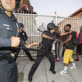 July 15, 2013 - Los Angeles, California, U.S - Protesters confront police officers during a demonstration to protest George Zimmerman's acquittal in the shooting death of Florida teen Trayvon Martin, on Monday July 15, 2013 in Los Angeles, California. Seventeen-year-old Martin was shot and killed in February 2012 by neighborhood watch volunteer George Zimmerman. (Credit Image: ? Ringo Chiu/ZUMAPRESS.com)