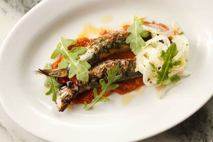 Sardines with tripe, tomato, olives, and fennel.