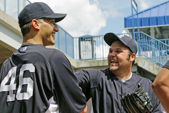Andy Pettitte, (46) who came out of retirement on a minor league contract to pitch for his former team, jokes around with Yankees reliever Joba Chamberlain after throwing in the bullpen at the Yankees spring training facility at Steinbrenner Field in Tampa, Fla., Tuesday, March 20, 2012.  (AP Photo/Kathy Willens)