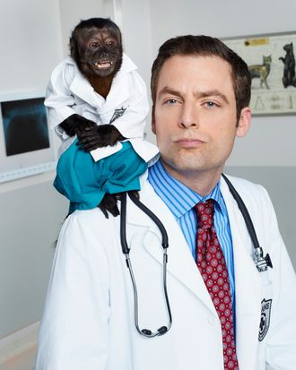 ANIMAL KINGDOM -- Season: Pilot -- Pictured: (l-r) Monkey as Dr. Zaius, Justin Kirk as Dr. George Coleman -- (Photo by: Chris Haston/NBC)