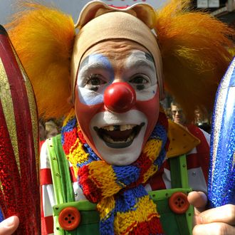 Clowns from the Ringling Bros. and Barnum & Bailey Clown Alley perform in Times Square March 9, 2011 as clowns and 125 other members of the cast arrive to participate in a juggling display in New York. The Greatest Show on Earth is at the IZOD Center til March 13th.AFP PHOTO / TIMOTHY A. CLARY (Photo credit should read TIMOTHY A. CLARY/AFP/Getty Images)