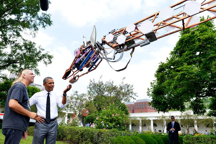 U.S. President Barack Obama (R) talks with Lindsay Lawlor of San Diego, California, the builder of a robotic giraffe at the White House Maker Faire projects on the South Lawn June 18, 2014 in Washington, DC. The Faire is a series of projects by students,  entrepreneurs and regular citizens using new technologies and tools to launch new businesses and learning new skills in science, technology, engineering and mathematics.