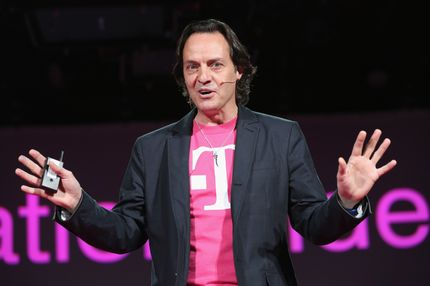 NEW YORK, NY - MARCH 26:  John Legere, CEO and President of T-Mobile USA, makes an announcement during an event about new contract pricing on March 26, 2013 in New York City. Legere confirmed that T-Mobile will start carrying the iPhone 5 starting April 12, under it's new no-contract plan called The Simple Choice, with the customers paying $99 down, then $20 a month for 24 months, on top of the monthly service plan. (Photo by John Moore/Getty Images)