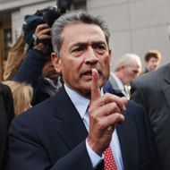 Rajat Kumar Gupta, former Goldman Sachs board member, leaves a Manhattan court after he surrendered to federal authorities October 26, 2011 in New York City.  Gupta is charged with conspiracy and securities fraud, stemming from a massive hedge fund insider trading case.