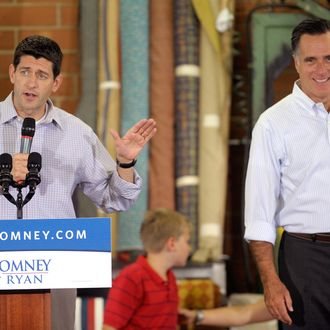HIGH POINT, NC - AUGUST 12: Republican presidential candidate, former Massachusetts Gov. Mitt Romney (R), is introduced by running mate Republican vice presidential candidate, U.S. Rep. Paul Ryan (R-WI) during a campaign stop at the Absolute Style furniture factory on August 12, 2012 in High Point, North Carolina. Romney and Ryan continue on the second day of a 4-day bus trip that will take Romney to 4 key swing states, Virginia, North Carolina, Florida and Ohio, and also to Ryan's home state of Wisconsin. (Photo by Sara D. Davis/Getty Images)