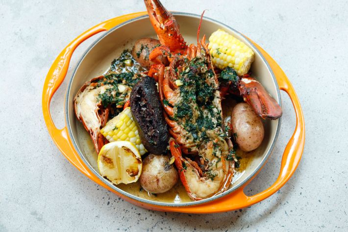 Lobster, blood sausage, garlic butter, corn, potatoes.
