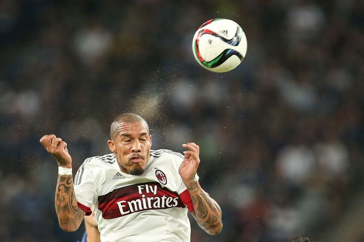 Migel de Jong #34 of AC Milan jumps to head the ball during a match between AC Milan and Inter Milan on July 25, 2015 in Shenzhen, China.