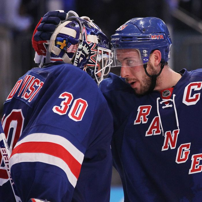 Henrik Lundqvist #30 and Ryan Callahan #24 of the New York Rangers celebrate their 3 to 0 win over the New Jersey Devils in Game One of the Eastern Conference Finals during the 2012 NHL Stanley Cup Playoffs at Madison Square Garden on May 14, 2012 in New York City.