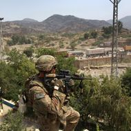 TORKHAM, AFGHANISTAN - AUGUST 27:  U.S. Army Sgt. David Ward watches over the border crossing between Afghanistan and Pakistan August 27, 2011 at Torkham, Afghanistan. The port of entry is busiest in Afghanistan and the most important for the U.S. military, which imports more than 30 percent of all its supplies and military equipment through Torkham.  (Photo by John Moore/Getty Images)